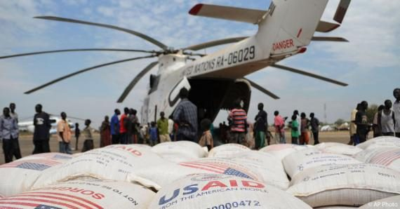 Helicopter with USAID food bags in the foreground